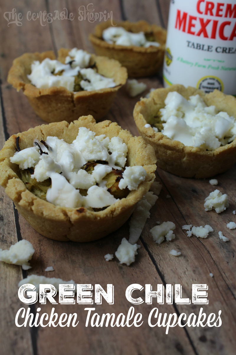 A wonderful Green Chile & Chicken Tamale Cupcake made with hatch green chiles and shredded chicken in a tamale-like cup, dressed with fresh cream and cheese.