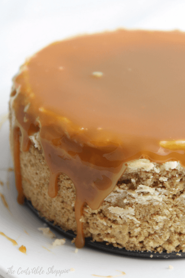 Creamy Instant Pot cheesecake topped with a deliciously rich caramel sauce - oh my gosh, this is SO good!