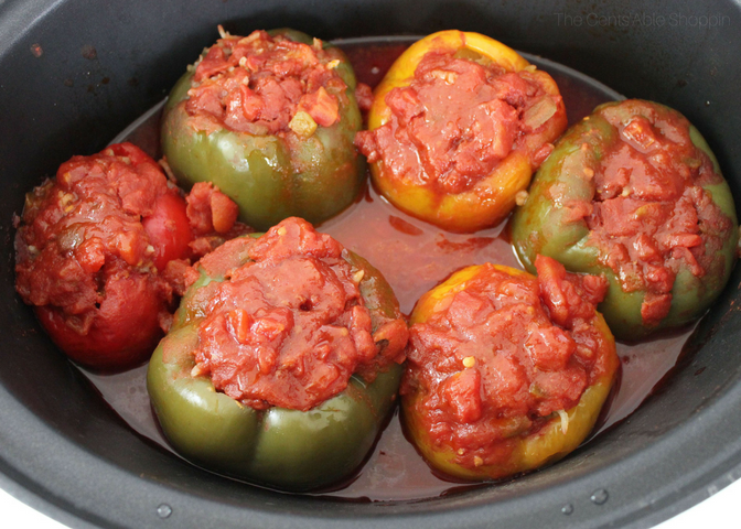 These crock pot stuffed peppers are an easy, healthy, and delicious way to cook without having to slave away in the kitchen. Throw them in the crock pot and they'll be ready when you get home from a busy day at work! #peppers #easy #healthy