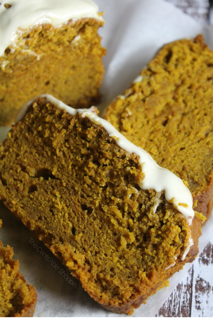 A moist and delicious pumpkin gingerbread, rich in fall spices and topped with a delectable maple-vanilla icing. This bread is a wonderful reason to cozy up by the fire and celebrate the season! #fall #gingerbread #pumpkin