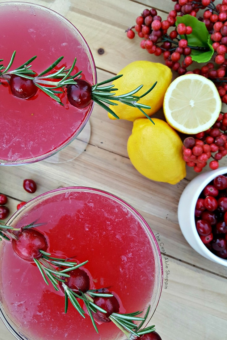 Cranberry Lemon Drop Martini - The Cents'Able Shoppin    A festive cranberry twist on a lemon drop martini recipe, using a homemade cranberry syrup for a bit of sweetness. Light, fruity and festive! #martini #cranberry #lemon #cocktail