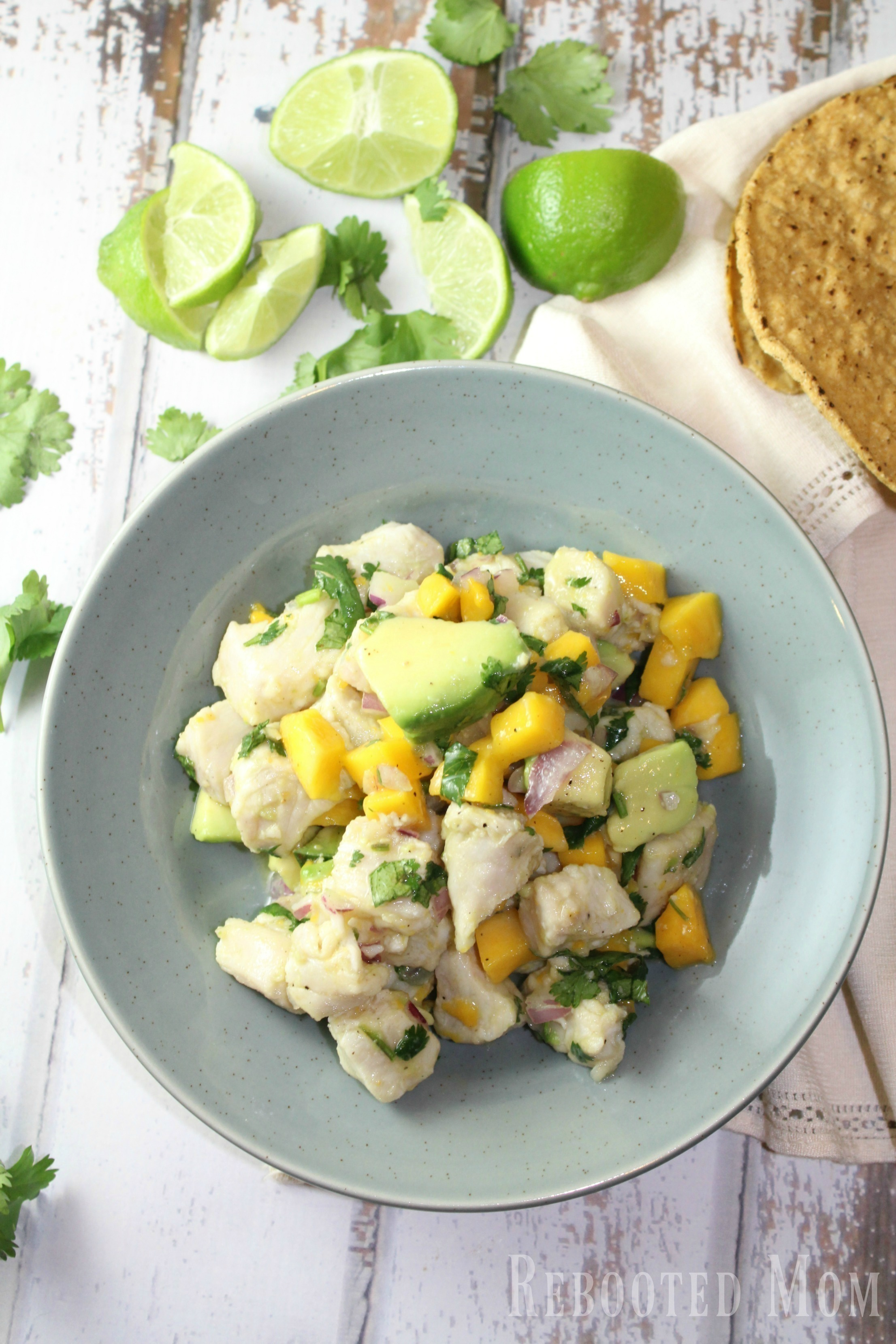 Tropical Mango Ceviche - Rebooted Mom    This tropical mango ceviche uses lemon or lime juice with mahi mahi fillets to cook the fish (through the acidic marinade) in just under 45 minutes. It's delicious!