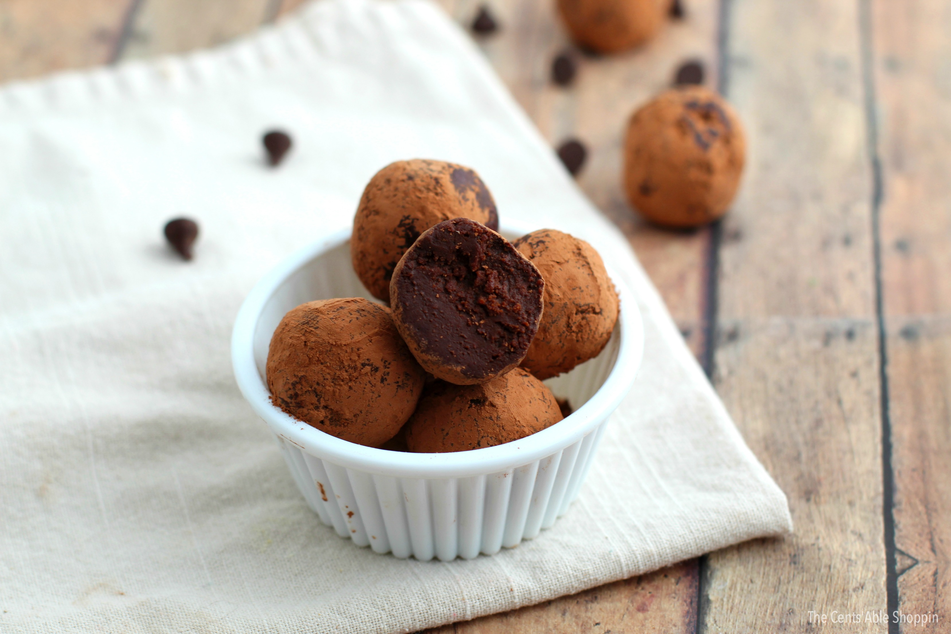 These Healthy Chocolate Fudge Truffles taste like heaven in a bite size snack! They are made quite easily with 4 simple ingredients!