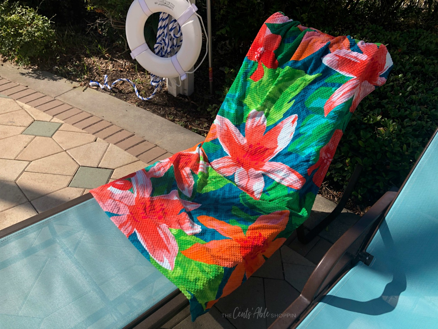 This simple beach towel DIY takes just minutes and will prevent your towel from slipping off your chair when relaxing around the pool or beach this summer!